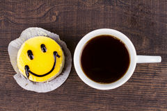 Coffee cup and smile cake. Royalty Free Stock Photos