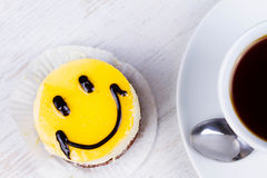 Coffee cup and smile cake. Stock Photography