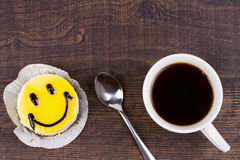 Coffee cup and smile cake. Stock Images