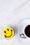 Coffee cup and smile cake. Stock Photos