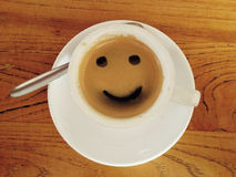 Coffee cup with smiley face Royalty Free Stock Photo