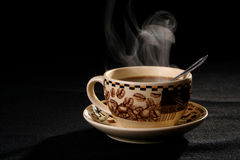 Coffee cup smoke. Sprightliness, cheerfulness, coffee-beans, tea-party, breakfast Royalty Free Stock Photo