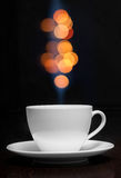 Coffee cup with smoke and abstract bokeh Stock Photo