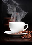 Coffee cup with smoke and grain Stock Image