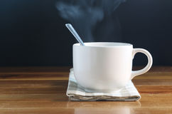 Coffee cup with smoke Stock Photos