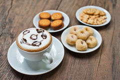 Coffee cup with snack on table Stock Photography