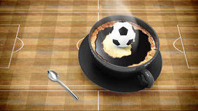 Coffee cup with soccer Royalty Free Stock Photography