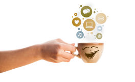 Coffee cup with social and media icons in colorful bubbles Royalty Free Stock Photography