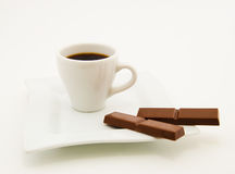 Сoffee cup and some slices of chocolate Stock Photography