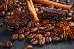 Coffee cup, spices and chocolate on wooden table texture with co. Py space royalty free stock photography