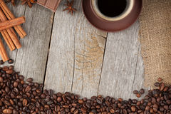 Coffee cup with spices and chocolate on wooden table texture Stock Photos
