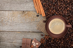 Coffee cup with spices and chocolate on wooden table texture Stock Images