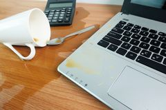 Free Coffee Cup Spill Out On Keyboard Laptop Computer And Smartphone On Wooden Floor Royalty Free Stock Images - 126188209