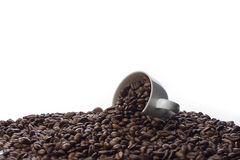 Coffee Cup and Spilled Coffee Beans Royalty Free Stock Image