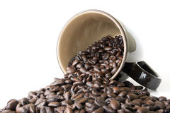 Coffee Cup With Spilled Espresso Beans Royalty Free Stock Photos