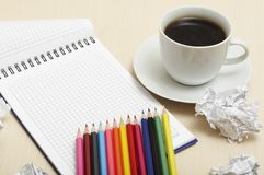 Coffee cup and spiral notebook Royalty Free Stock Photo