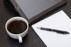 Coffee cup, spiral notebook and pen Stock Images