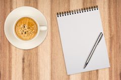 Coffee cup, spiral notebook Royalty Free Stock Images