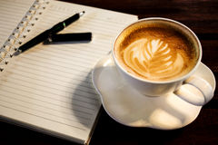 Coffee cup, spiral notebook and pen Royalty Free Stock Photography