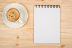 Coffee cup, spiral notebook Royalty Free Stock Image