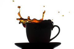 Coffee cup splash. A splash from a silhouette of a coffee cup Royalty Free Stock Images