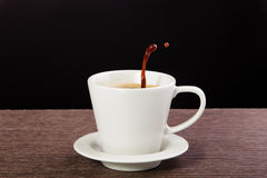 Coffee cup with splash Stock Photo