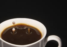 Coffee cup splashes Royalty Free Stock Photography