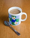 Coffee cup and spoon. On table Royalty Free Stock Image