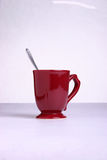Coffee cup with spoon. A studio image of a red coffe cup with a spoon Stock Photo