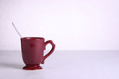 Coffee cup with spoon. A studio image of a red coffe cup with a spoon Stock Photos