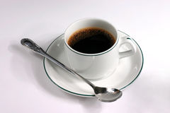 Coffee cup with spoon Stock Photo