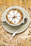 Coffee cup with spoon. On wood table Stock Images