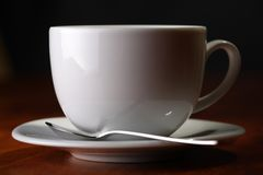 Coffee cup with spoon Royalty Free Stock Photography
