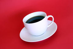 Coffee Cup Without Spoon. A coffee cup on a red background Stock Photography