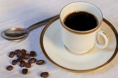 Coffee cup. With spoon and coffee beans Stock Photos