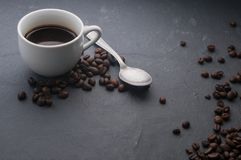 Coffee cup with spoon and coffee beans Stock Image