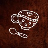 Coffee cup and spoon on brown textured background Royalty Free Stock Photos