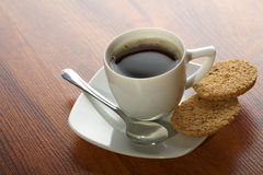 Coffee cup with spoon and cookies Royalty Free Stock Photos
