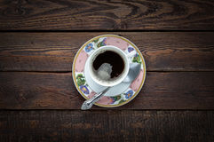 Coffee cup with spoon on dark wood table. Top view Royalty Free Stock Photo