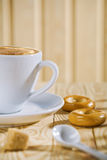 Coffee cup and spoon on table Royalty Free Stock Images