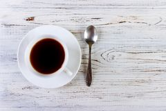 Coffee in a cup with spoon on a white background Royalty Free Stock Photo