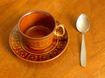Coffee Cup and Spoon On Wooden Table Royalty Free Stock Image