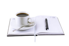 Coffee cup, standing on the daily organizer. Stock Images