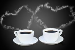 Coffee cup with steam Stock Images