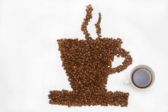 Coffee cup and steam made from beans, grain.  on white b Stock Image