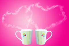 Coffee cup with steam shaped as heart Stock Photography