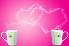 Coffee cup with steam shaped as heart Stock Images