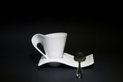 Coffee cup. With steel spoon and black background Royalty Free Stock Photography