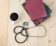 Coffee cup and stethoscope,  concept for doctor Stock Image