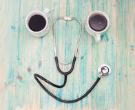 Coffee cup and stethoscope, relaxing concept Royalty Free Stock Images